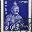A stamp printed in Japan shows a metal sculpture of K��mokuten. One of the four heavenly guardians, the king of the West - Stock Photo