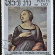 "Stock Photo: Stamp printed in Laos shows painting ""Catherine of Alexandria"" by Raphael,500th anniversary of Raphael"