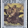 "Stock Photo: Stamp printed in Laos shows painting""Vision of Ezekiel"" by Raphael,500th anniversary of Raphael"