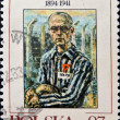 Stock Photo: Stamp printed in Poland shows MaximilliKolbe, friar who volunteered to die in place of stranger at Auschwitz
