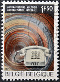 A stamp printed in Belgium celebrating the inauguration of the Automatic Telephone Service — Stock Photo