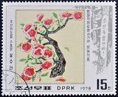 在朝鲜邮票显示图像的梅花 — 图库照片
