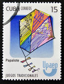 A stamp printed in Cuba dedicated to traditional games, shows a kite (papalote) — Stock Photo