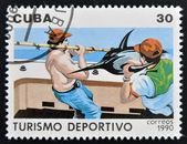 Un francobollo stampato a cuba dedicati al turismo sportivo, illustrato pesca — Foto Stock