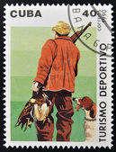 A stamp printed in Cuba dedicated to sports tourism, shows hunting — Stock Photo