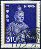 A stamp printed in Japan shows a metal sculpture of K��mokuten. One of the four heavenly guardians, the king of the West — Stock Photo
