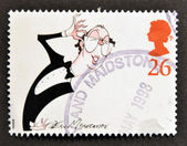 A stamp printed in Great Britain shows Eric Morecombe, comedian — Stock Photo