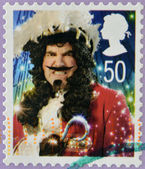 A Christmas stamp printed in Great Britain shows Captain Hook from Peter Pan — Stock Photo