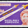A stamp printed in Cuba shows Nikolayev and Popovich with rocket Vostok 3 and 4 — Stock Photo #13552707