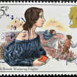 A stamp printed in Great Britain showing a drawing the writer Emily Bronte: Whuthering Heights - Stock Photo