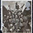 A stamp printed in Great Britain shows British Troops and French Civilians celebrating End of the Second World War — Stock Photo #13552947