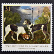 Stock Photo: Stamp printed in Great Britain shows Two hounds in landscape, painting by George Stubbs