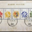 Постер, плакат: Stamps printed in Great Britain shows Hogwarts Crests Harry Potter