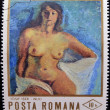 Stamp printed in Romania shows painting of naked woman by Josef Iser — Stock Photo