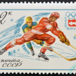 Stock Photo: Stamp printed in USSR Russishows Winter Olympic Games Emblem and Ice Hockey