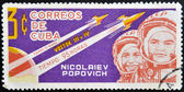 A stamp printed in Cuba shows Nikolayev and Popovich with rocket Vostok 3 and 4 — Stock Photo