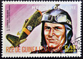 Stamp printed in Guinea dedicated to air heroes, shows Tuominien, historic aviator of the Second World War — Stock Photo
