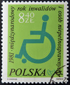 A stamp printed in Poland shows Logo with a Wheelchair — Stock Photo