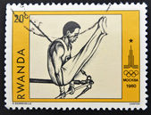 A stamp printed in Rwanda shows athlete — Stock Photo