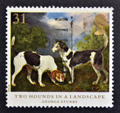 A stamp printed in Great Britain shows Two hounds in a landscape, painting by George Stubbs — Stock Photo