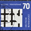 Stamp printed in Germany dedicated to  Amnesty International shows Broken Bars of prison Window — Stock Photo