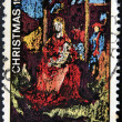 Stamp printed in Australishows abstract art of virgin Mother Mary holding baby Jesus — Photo #13669343