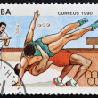 A stamp printed in Cuba dedicated to Olympic Games in Barcelona 1992 shows two fighters in a combat, — Stock Photo