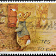 Stock Photo: UNITED KINGDOM - CIRC1994: stamp printed in Great Britain shows Peter Rabbit posting Letter, circ1994