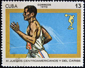 A stamp printed in Cuba shows the running athlete — Stock Photo
