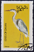 STATE OF OMAN - CIRCA 1977: stamp printed in State of Oman dedicated to the birds shows Heron, circa 1977 — Stock Photo