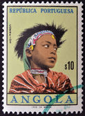 A stamp printed in Angola shows portrait of a child Angolan traditional clothes — Stock Photo