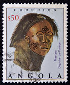 A stamp printed in Angola shows leather mask with painted decoration — Stock Photo