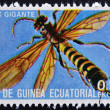 Stock Photo: EQUATORIAL GUINE- CIRC1973: stamp printed in Guinededicated to insects shows giant sirex, circ1973