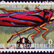 Stock Photo: EQUATORIAL GUINE- CIRC1973: stamp printed in Guinededicated to insects shows grasshopper West Africa, circ1973