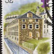 Stock Photo: UNITED KINGDOM - CIRC1989: stamp printed in Great Britain dedicated to Industrial Archaeology, shows Cotton Mills, New Lanark, Strathclyde, circ1989