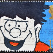 Stock Photo: UNITED KINGDOM - CIRC1990: stamp printed in Great Britain shows Dennis Menace, circ1990