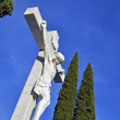 Foto de Stock  : Crucified sculpture in cemetery