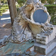 Stock Photo: Statue of womwith mirror in cemetery