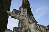 Statue of an angel with a cross at the Cemetery — Stok fotoğraf