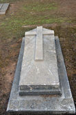 Old stone grave with a cross — Stock Photo