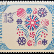 A stamp printed in Bulgaria shows snowflake, a symbol of the new year's holiday - Stock Photo