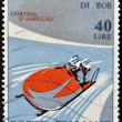 图库照片: Stamp printed in Italy shows Two-mbobsled