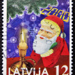 A christmas stamp printed in Latvia shows papa noel, santa claus — Foto de Stock