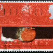 A stamp printed in Great Britain shows image of a robin sitting in a postbox — Stock Photo
