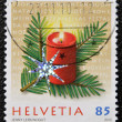 HELVETIA (SWITZERLAND) - CIRCA 2009: A christmas stamp printed in Switzerland shows candle — Stock Photo