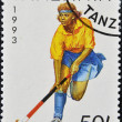 Foto de Stock  : Stamp printed in Tanzanishows hockey
