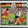 Stock Photo: A stamp printed in Tanzania dedicated to FIFA World Cup, USA, 1994 shows footbal players