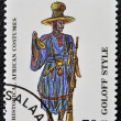 图库照片: Stamp printed in Tanzanidedicated to historical africcostumes, shows goloff style,