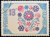 A stamp printed in Bulgaria shows snowflake, a symbol of the new year's holiday — Stock Photo