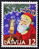 Christmas stempla drukowane w łotwa pokazuje papa noel, święty mikołaj — Zdjęcie stockowe